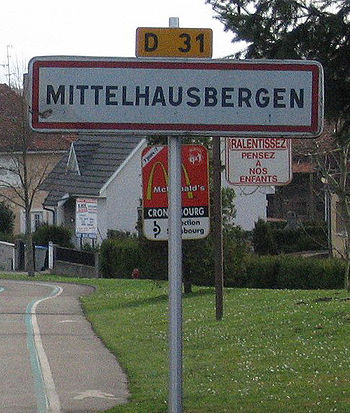 Road sign marking the entrance of Mittelhausbergen in the Bas-Rhin département, Alsace.