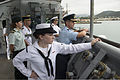 Partner nation military members watch as U.S. Sailors pull the amphibious dock landing ship USS Pearl Harbor (LSD 52) into port in Noumea, New Caledonia, during Pacific Partnership 2013 June 25, 2013 130625-N-SP369-105.jpg