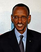 Close up photo of Paul Kagame smiling at the premiere of the film Earth Made of Glass
