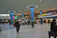 Penn Station concourse with escalators and stairs in the background