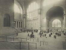 The main waiting room with stairs in the foreground, and a statue of PRR President Alexander Johnston Cassatt on the left.