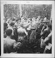 Personnel of VB104 & VB106 gather around Chief Yeoman Willis to receive their mail on Munda, New Georgia Island. - NARA - 520909.tif
