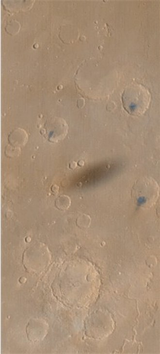 Transit of Phobos from Mars - The penumbral shadow of Phobos on the Martian landscape, as seen by Mars Global Surveyor on 26 August 1999. The center of the shadow was at 10.9°N 49.2°W at 04:00:33 UTC