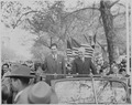 Photograph of President Truman and President Miguel Aleman of Mexico standing in an open limousine during a welcoming... - NARA - 199556.tif