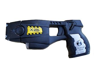 Police issue X26 TASER device with cartridge installed Police issue X26 TASER-white.jpg