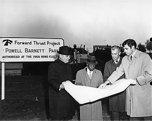Central District, Seattle - Athlete, musician, and community activist Powell Barnett (second from left) in 1970, looking at the plans for the park named after him on the east side of Martin Luther King, Jr. Way (then Empire Way) between E. Alder and E. Jefferson Streets.