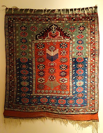 Prayer rug - Bergama prayer rug, late 19th century. The niche at the top represents the mihrab and the direction of prayer.