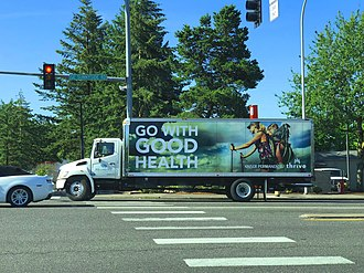 Out-of-home advertising - A printed mobile billboard truck advertising