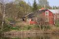 Pyttis Österkyrkoby, äldre gård vid älven.png