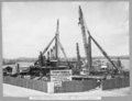 Queensland State Archives 3604 Main bridge erection stage 2 deck crane back at north anchor pier Brisbane 22 November 1937.png