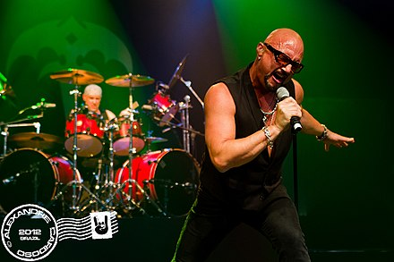 Drummer Scott Rockenfield and singer Geoff Tate performing with Queensryche in Sao Paulo, Brazil on April 14, 2012. Tate would repeatedly spit at Rockenfield during this show. Queensryche no Brasil-8.jpg