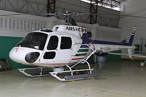 ABS-CBN (TV network) - One of the three Eurocopter AS350 Écureuil news helicopters of ABS-CBN in a hangar in Mactan-Cebu International Airport mounted with a five-axis gimbal HD camera.