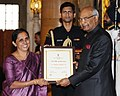 Ram Nath Kovind presenting the Nari Shakti Puruskar for the year 2017 to Dr. Lizymol Philipose Pamadykandathil, Thiruvananthapuram, Kerala, at a function, on the occasion of the International Women's Day.jpg