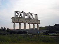 "Ornate outdoor sign on pillars, reading ""Ramoji Film City"""