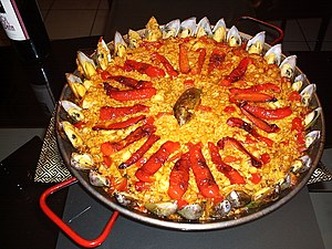 A red paella with mussels.