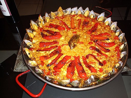Red paella with mussels
