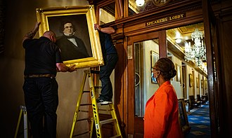 Capitol workers remove the portrait of former House Speaker Howell Cobb of Georgia from a wall in the Speaker's Lobby of the U.S. Capitol Removal of Howell Cobb portrait.jpg