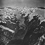 Rendu Glacier, rock covered tidewater glacier terminus, icefield, and hanging glaciers, September 12, 1973 (GLACIERS 5827).jpg
