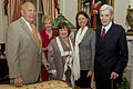 Retired U.S. Sen. John Warner, right, the Evening Parade guest of honor and a former secretary of the Navy, poses for a photo with his wife, Jeanne Vander Myde Warner, second from right; Bonnie Amos, second from 130503-M-LU710-137.jpg