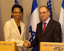 Rice shakes hands with former Israeli Foreign Minister Silvan Shalom in a July 2005 visit to Israel