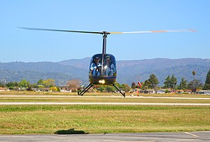 Robinson R22 Helicopter hovering.jpg