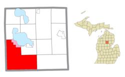 Location within Roscommon County (red) and a portion of the administered community of Houghton Lake (pink)
