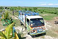 SOIL Poopmobile delivering buckets of waste to the SOIL composting facility in Port-au-Prince.jpg