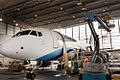 SSJ100 for Interjet - Painting the livery (8463918167).jpg