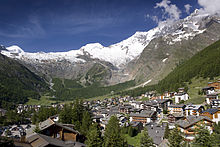 View on the village of Saas-Fee in summer with the mountain panorama in the background.