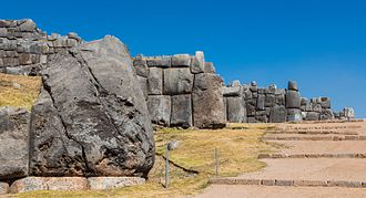 Sacsayhuamán - Sideways view of the walls of Sacsayhuamán showing the details of the stonework and the angle of the walls.