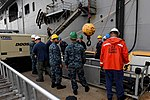 Sailors from USS Iwo Jima loads supplies prior to the ship getting underway. (29564412153).jpg