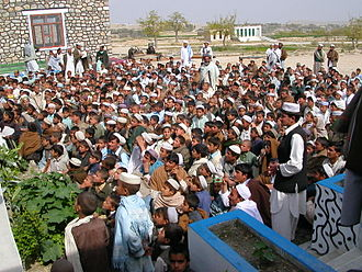 Demographics of Afghanistan - Gathering of students in 2006 at a school in Nangarhar Province.