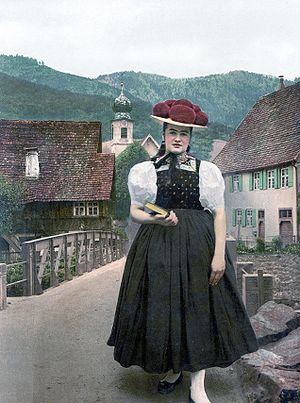 Tracht - Tracht of  Gutach in the Black Forest, around 1900. The red colour of the pompons indicates that the woman was unmarried.