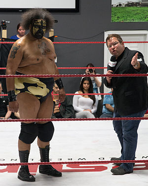 Scott D'Amore - Scott D'Amore (right) addressing fans with wrestler Kongo Kong looking on, in May 2015
