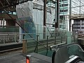 See-through from the interior of Central Station The Hague, tram platform with escalator; high resolution image by FotoDutch, June 2013.jpg