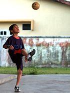 A child demonstrating sepak takraw.