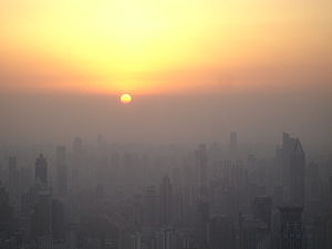 Puxi area of Shanghai at sunset. The sun has not actually dropped below the horizon yet, rather it has reached the smog line.
