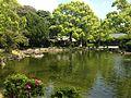 Shinjiike Pond and Chokushikan Hall of Munakata Grand Shrine (Hetsu Shrine).JPG
