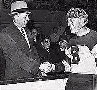 Ace Bailey (left) shakes the hand of Eddie Shore at the benefit All-Star  Game held in honour of Bailey. b8b1ce976