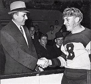 Ace Bailey - Bailey (left) shakes the hand of Eddie Shore at the benefit All-Star Game held in honour of Bailey.