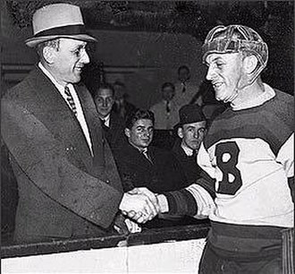 Eddie Shore - Ace Bailey (left) shakes the hand of Eddie Shore at the benefit All-Star Game held in honour of Bailey.