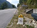 Signpost with details of the climb seen from Maurienne Valley.jpg