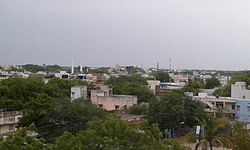 Image of the town with mosque amidst a housing locality