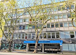 Skempton Building, Imperial College Road angled towards Queen's Lawn in April.jpg