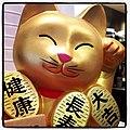 Smiling cat statue (8336740022).jpg