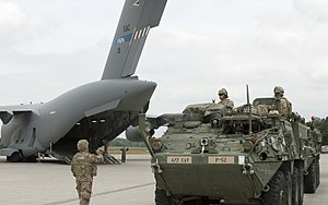 Soldiers assigned to 2nd Cavalry Regiment prepare Strykers to board a C-17 aircraft at the Nuremberg Airport, Germany.jpg