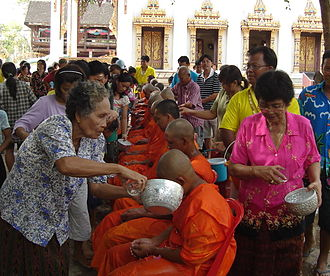 Songkran (Thailand) - Monks receiving blessing at a temple in Ban Khung Taphao