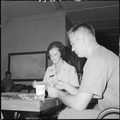 South Vietnam....Loretta Clause plays cards, talks, etc., with Marines of H&S, 1st Marine Division. She is a... - NARA - 532478.tif