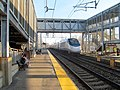 Southbound Acela Express passing through Canton Junction station, April 2016.JPG