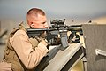 Special Reaction Team member, Provost Marshall's Office, Headquarters Battalion, Marine Corps Air Ground Combat Center, fires M-4 service rifle during a training excercise.jpg